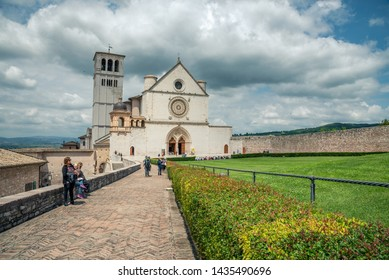 Assisi, Italy - May 22 2019: View of famous Basilica of St. Francis of Assisi (Basilica Papale di San Francesco) in beautiful spring day Assisi, Umbria, Italy