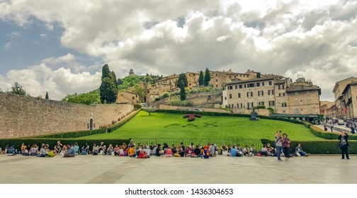 Assisi, Italy - May 22 2019: Group of tourists outside the Basilica of San Francesco d'Assisi in Italy, view of Assisi, the Umbria region, Italy.