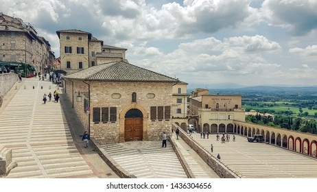 Assisi, Italy - May 22 2019: Outside the Basilica of San Francesco d'Assisi in Italy, panorama view of Assisi, the Umbria region, Italy.
