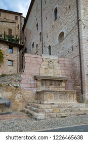 ASSISI, ITALY - OCTOBER 27, 2018:  stone fountain in the medieval city of Assisi
