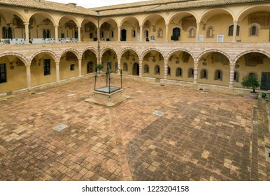 ASSISI, ITALY - OCTOVER 27, 2018: inner courtyard in Basilica of Saint Francis of Assisi