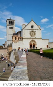 ASSISI, ITALY-JULY 9, 2013: Visitors approach the Papal Basilica of Saint Francis of Assisi.