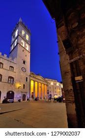Assisi, Umbria, Italy - September 11, 2018: Assisi Old Town - Piazza del Comune - Chiesa di Santa Maria sopra Minerva ad Assisi
