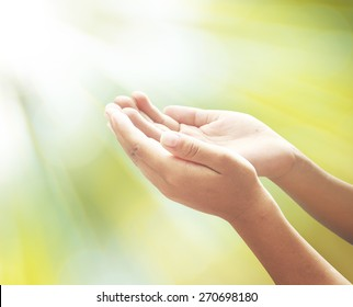 Assist surrender concept: Someone open two empty hand with palms up for praying to God