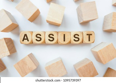 Assist word on wooden cubes
