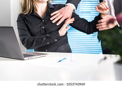 Assistant defending herself from boss in office. Sexual harassment and abuse at work concept. Physical fight at workplace.