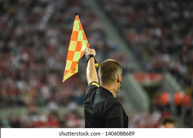 Assistant of football referee raise the flag up.