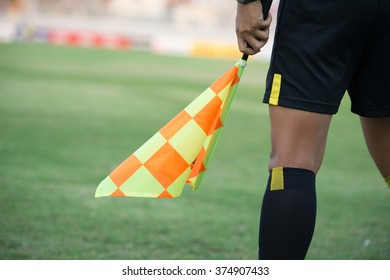 Assistant football referee and Referee's flag