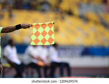 Assistant referee hold flag,offside signal
