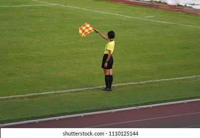 Assistant referee hold flag,signal offside