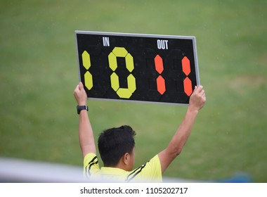 Assistant referee hold up substitution board