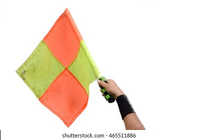 Assistant referee raise flag for offside