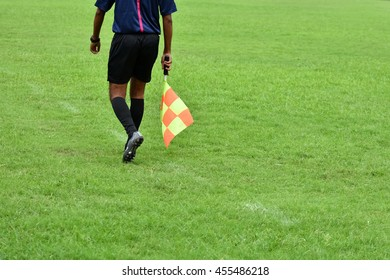 Assistant referee running along the sideline.