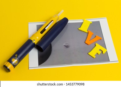 Assisted reproductive technology - injection pen and photo of the embryo, 5 days, on yellow background. In Vitro Fertilization IVF Health Care Modern concept. Medication Infertility