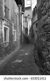 Asso (Como, Lombardy, Italy): typical street in the historic town. Black and white
