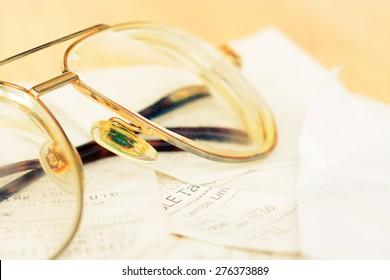 Assort billing receipt on table