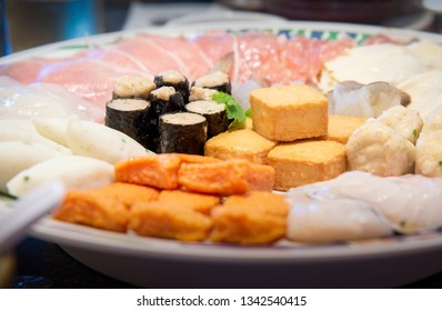 Assort many of Suki Hotpot Shabu set on hot pot, pork, fish, mussel, squid, egg, shrimp, fish ball ,Seaweed ,fish tofu ,woo