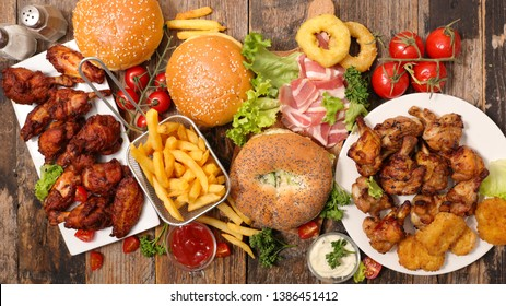 assorted of american food, French fries, hamburger, nugget, bacon