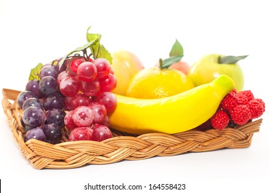 Assorted artificial fruits on white background