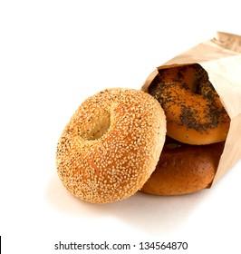 Assorted bagels in brown paper bag