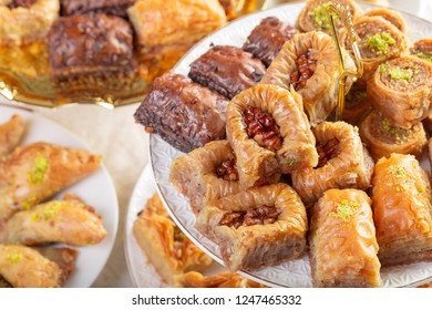 Assorted baklava- A Turkish sweet arranged on a decorative plate. Middle eastern food photography.