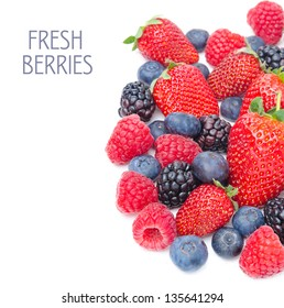 assorted berries isolated on a white background, top view (strawberries, blackberries, raspberries, blueberries)