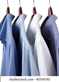 Assorted blue dress hanging on wooden hangers
