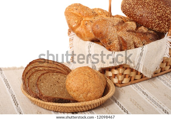 Assorted bread in basket and palte, isolated on white background
