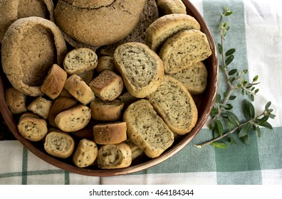 Assorted bread rusks on tablecloth.