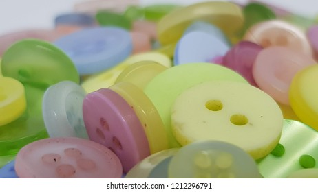 Assorted buttons piled up.