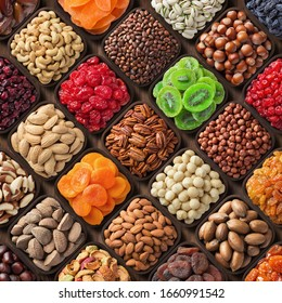 assorted candied berries, dried fruits, nuts and seeds, top view. healthy food background - Shutterstock ID 1660991542