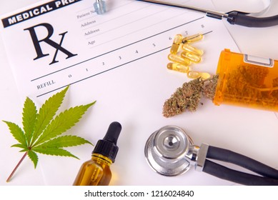 Assorted cannabis products, pills and cbd oil over medical prescription sheet - medical marijuana concept
