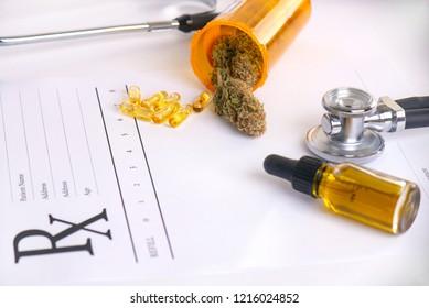 Assorted cannabis products, pills and cbd oil over medical prescription sheet - medical marijuana concept