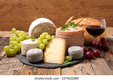 assorted of cheese and wine