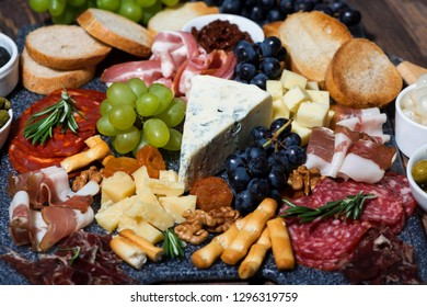 assorted cheeses and meats, closeup