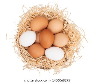 Assorted chicken, hens eggs in one basket isolated on white. Different colors: brown white and speckled.