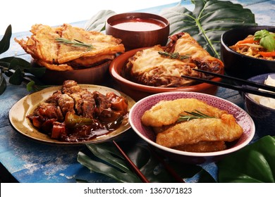 Assorted Chinese food set. Chinese noodles, fried rice, peking duck, dim sum, spring rolls. Famous Chinese cuisine dishes on table. Chinese restaurant concept. Asian style banquet