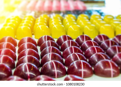 Assorted chocolate candies in candy store with various colors and sizes.  Deliciouos chocolates with assorted colors for sale in candy shop.