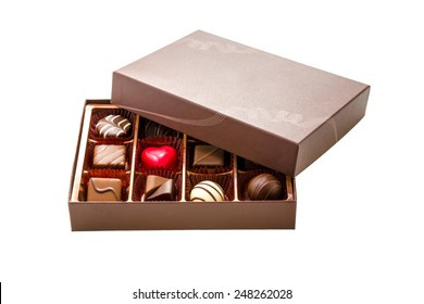 Assorted chocolates in brown box, with lid half off