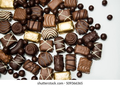 Assorted chocolates on white background