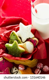 Assorted christmas cookies on red background.