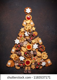 Assorted Christmas cookies in the shape of a Christmas tree. Top view.