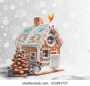 Assorted Christmas gingerbread cookies. Christmas gingerbread village, house, tree. Christmas New Year's background snowflakes. Christmas card with gingerbread house, Christmas tree, Santa Claus