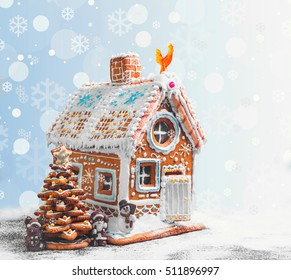 Assorted Christmas gingerbread cookies. Christmas gingerbread village, house, tree. Christmas New Year's background with snowflakes. Christmas card with gingerbread house, Christmas tree, Santa Claus