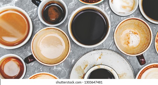 Assorted coffee cups on a marble background