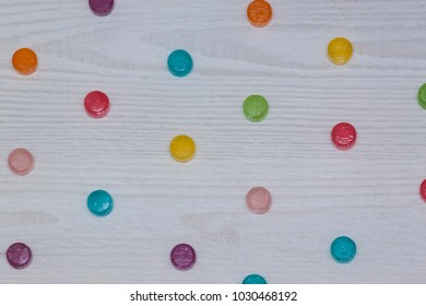 assorted colored candies on the white wooden table