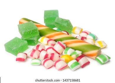 Assorted colored candies on white background