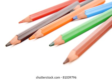 Assorted colored pencils placed in a mixed manner, isolated on white