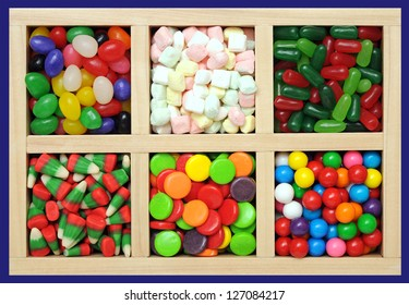 assorted colorful fruit flavor candies in wooden box