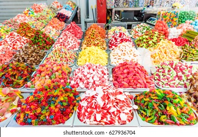 Assorted colorful gummy candies at market